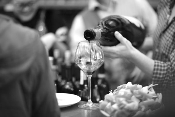 the crown sunday wine club wine pouring black and white